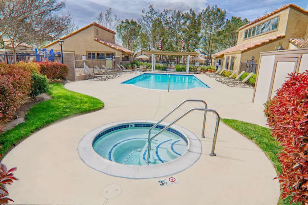 Hot tub and swimming pool at Granada Villas Apartment Homes in Lancaster, California