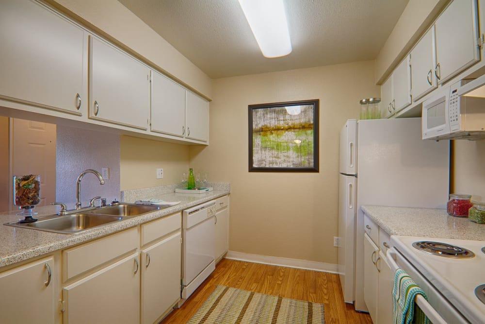 Kitchen in apartment at Granada Villas Apartment Homes in Lancaster, California