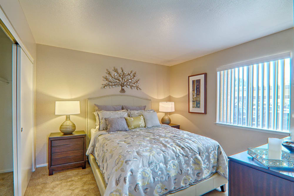 Well-lit bedroom at Granada Villas Apartment Homes in Lancaster, California