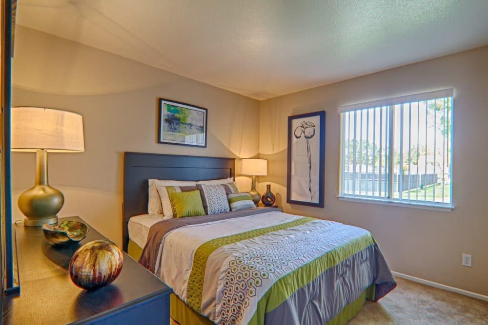 Master bedroom in apartment at Granada Villas Apartment Homes in Lancaster, California
