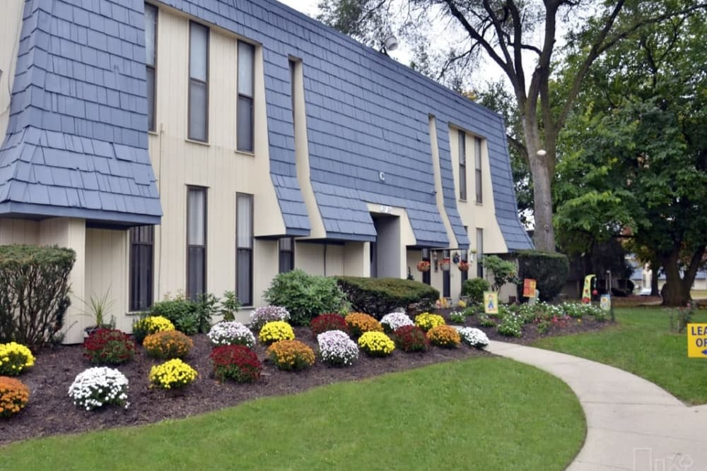 Well-maintained gardens outside resident buildings at Pine Ridge in Lindenwold, New Jersey
