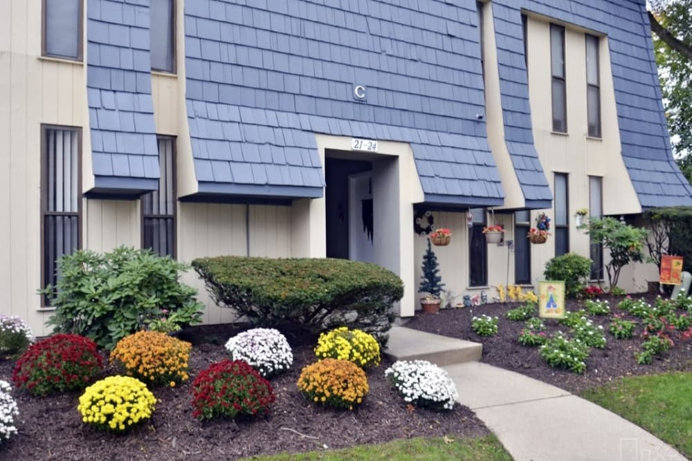 Exterior view of leasing office and well-maintained landscaping at Pine Ridge in Lindenwold, New Jersey