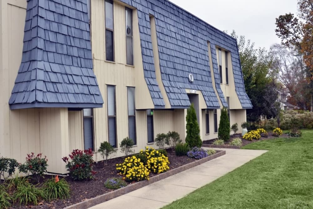 Exterior view of resident building and well-manicured lawn at Pine Ridge in Lindenwold, New Jersey