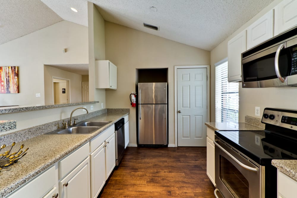 Kitchen for resident use in the clubhouse at The Arbors of Carrollton in Carrollton, Texas