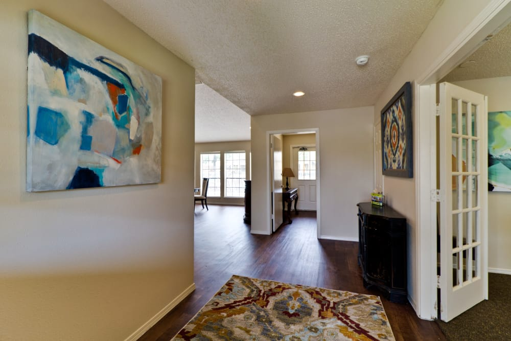 Hallway with contemporary art in the clubhouse at The Arbors of Carrollton in Carrollton, Texas