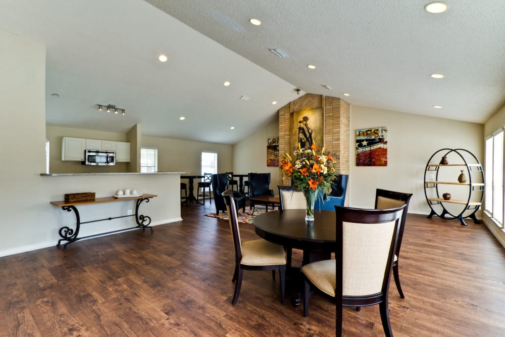Hardwood floors throughout the resident clubhouse at The Arbors of Carrollton in Carrollton, Texas