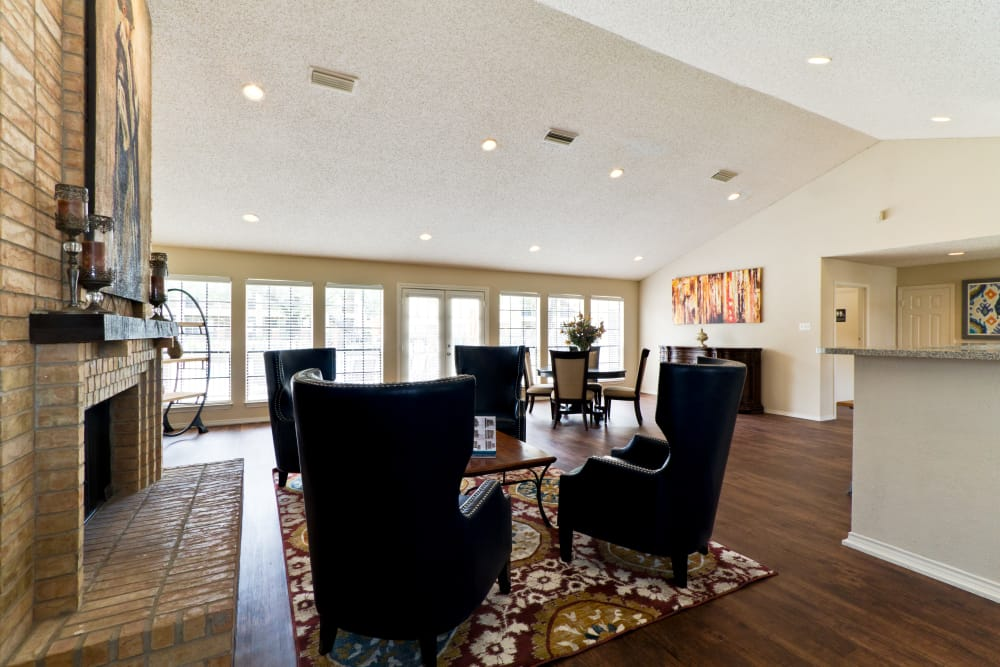 Hardwood floors, fireplace, and more in the clubhouse at The Arbors of Carrollton in Carrollton, Texas