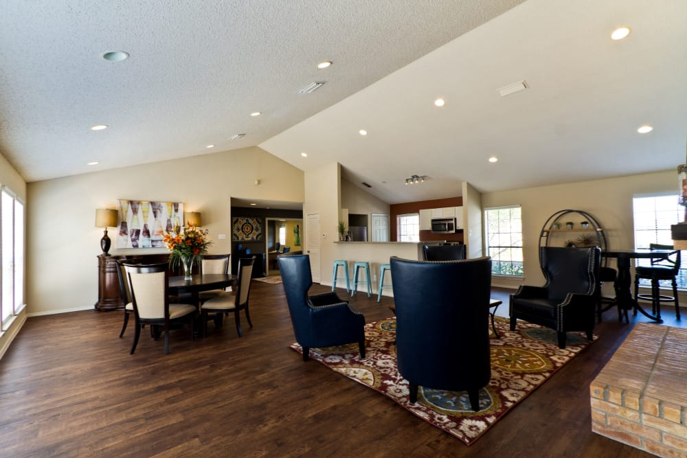 Comfortable seating and hardwood floors in the clubhouse at The Arbors of Carrollton in Carrollton, Texas