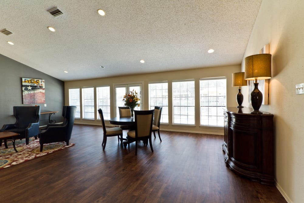 Hardwood floors and areas to chat with your friends and neighbors in the clubhouse at The Arbors of Carrollton in Carrollton, Texas