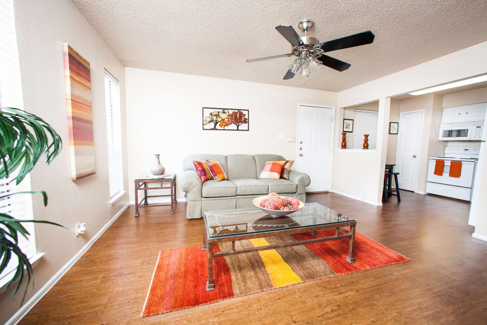 Spacious, open-concept floor plan with ceiling fan in model home at Ashley Oaks in San Antonio, Texas