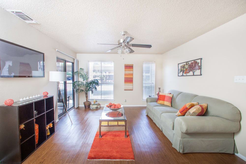 Ceiling fan and hardwood floors in model home's living area at Ashley Oaks in San Antonio, Texas