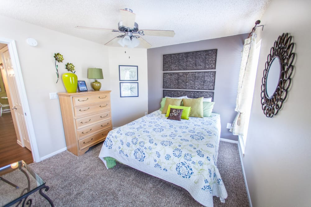 Bedroom with ceiling fan in model home at Ashley Oaks in San Antonio, Texas