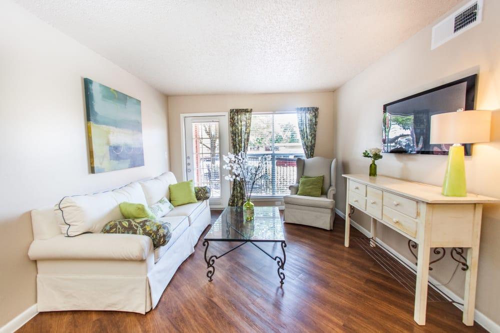 Modern decor and hardwood floors in model home's living area at Ashley Oaks in San Antonio, Texas