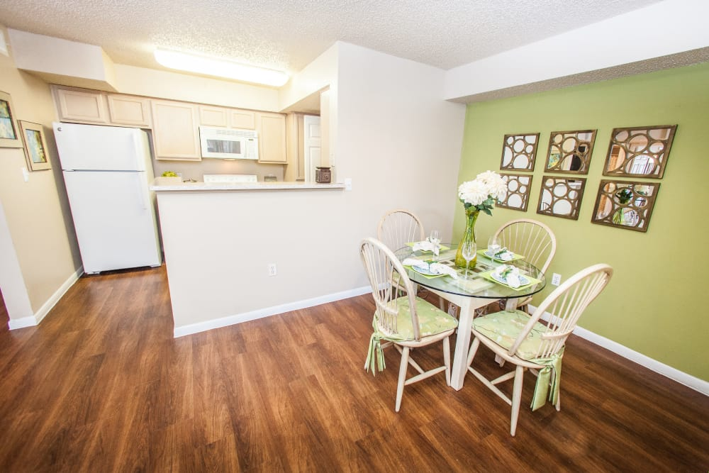 View of kitchen and dining area from model home's living area at Ashley Oaks in San Antonio, Texas
