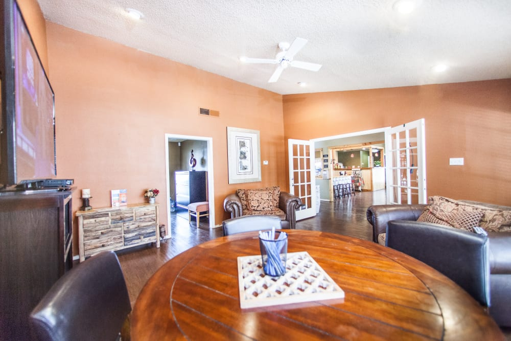 Ceiling fan and comfortable seating in the resident clubhouse at Ashley Oaks in San Antonio, Texas