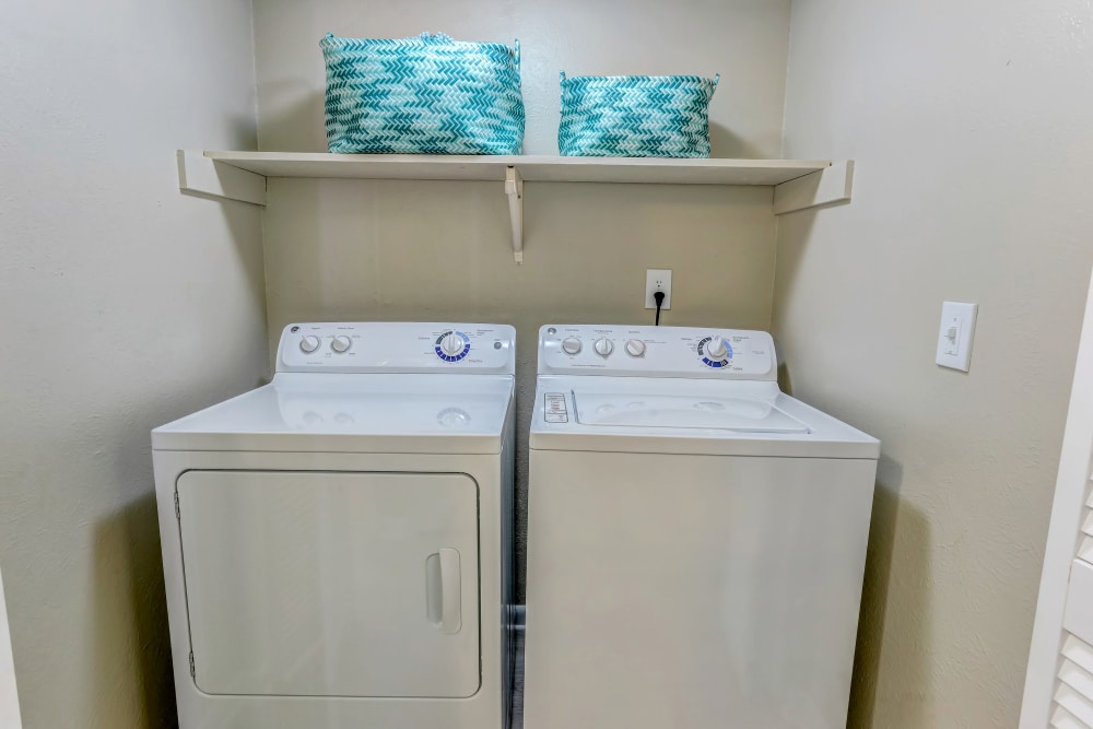 Dryer and laundry washer at Sheffield Heights Apartment Homes in Nashville, Tennessee