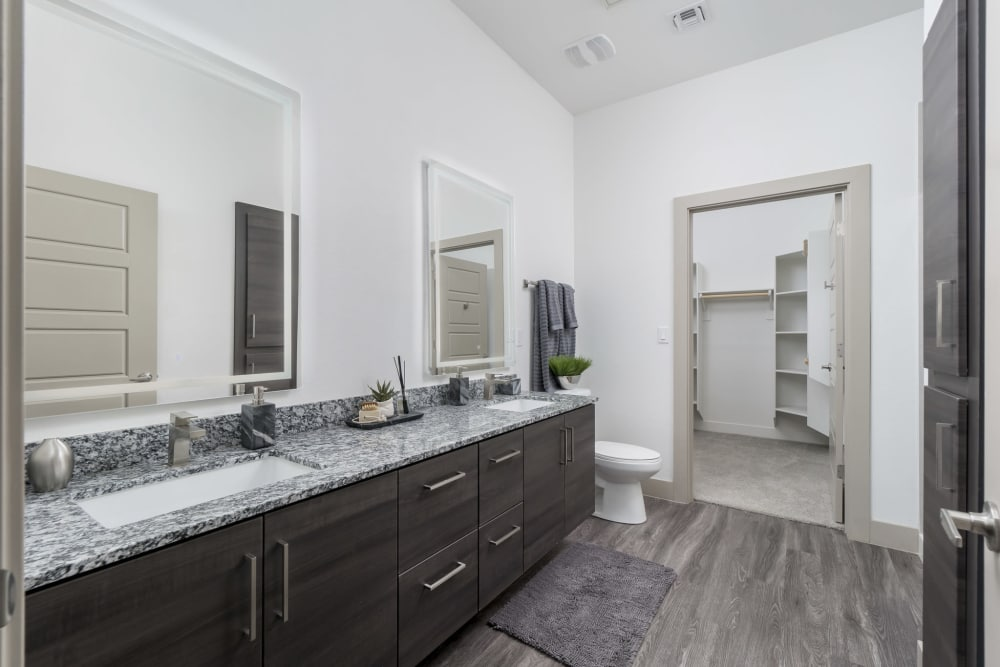 Apartment bathroom leading to the walk-in closet at The District at Scottsdale in Scottsdale, Arizona