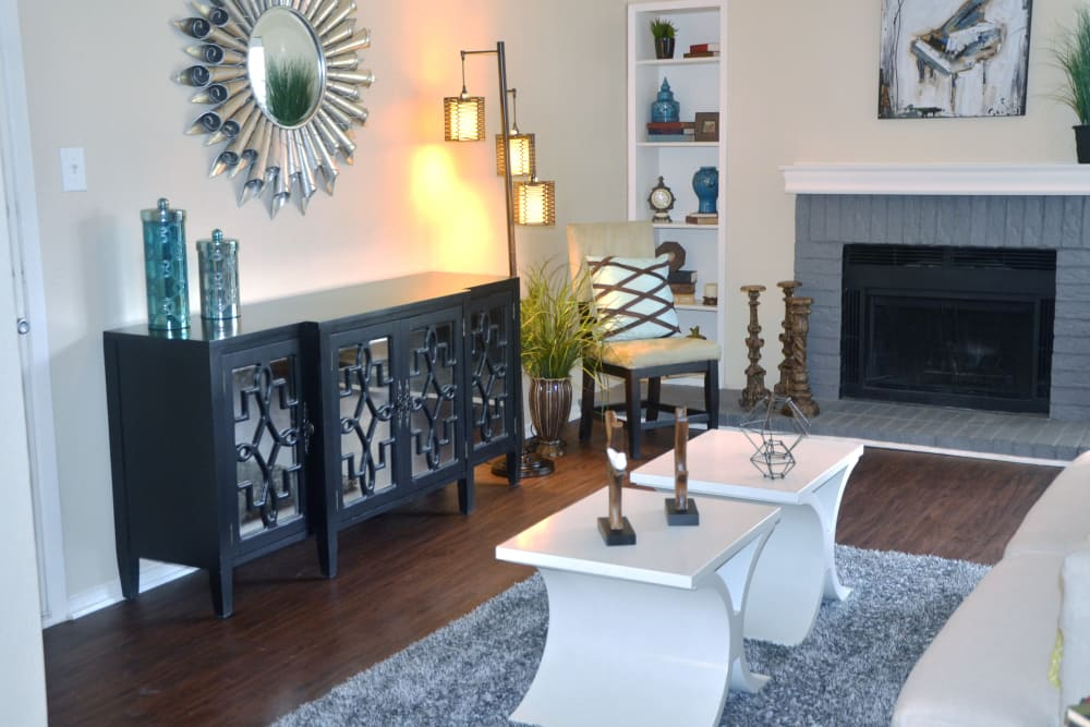 Hardwood floors and fireplace in model home at Grayson Ridge in North Richland Hills, Texas