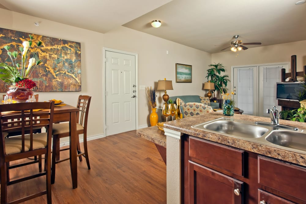 View of dining area from model home's kitchen at The Hills at Fair Oaks in Fair Oaks Ranch, Texas