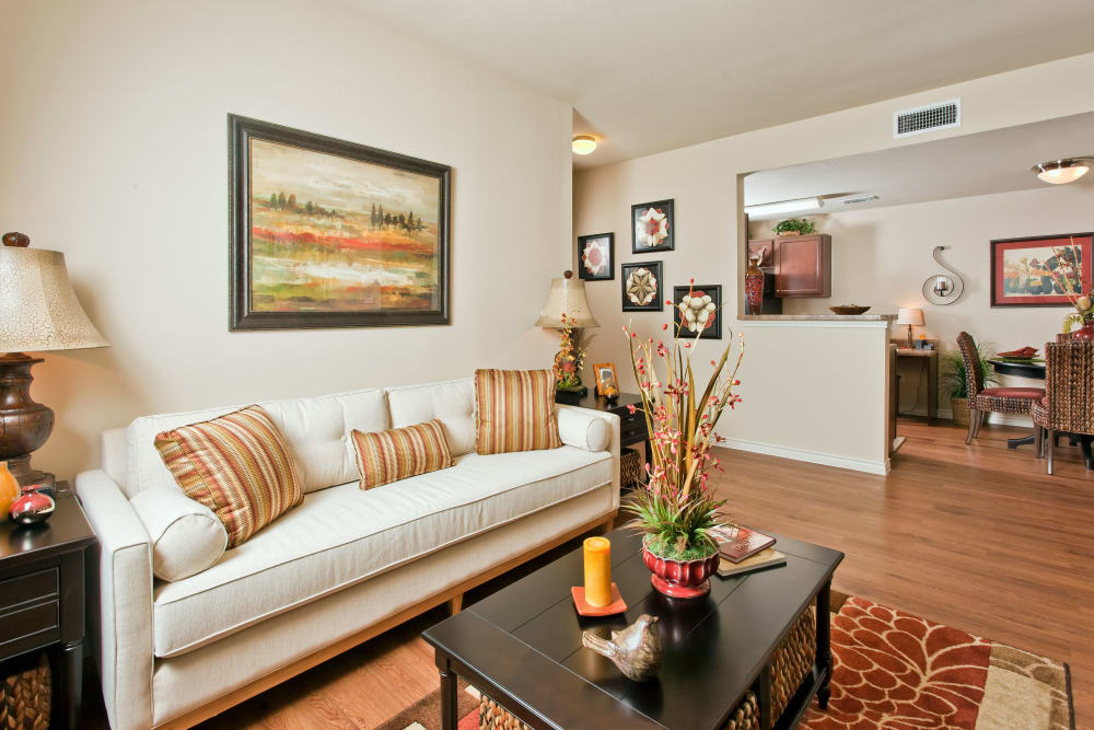 Open-concept floor plan with hardwood floors in model home at The Hills at Fair Oaks in Fair Oaks Ranch, Texas