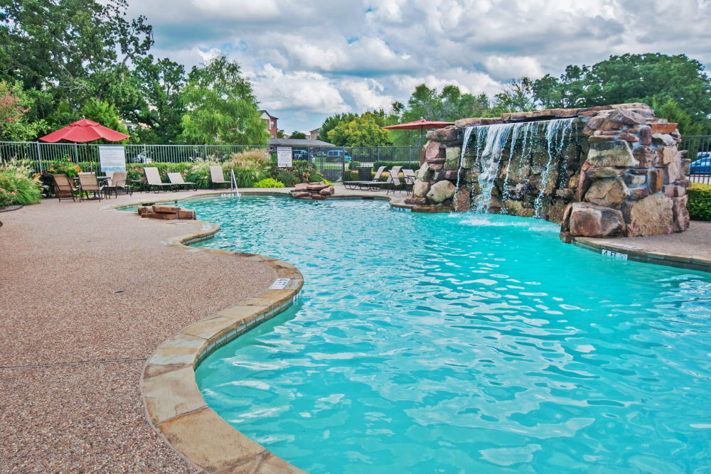Waterfall feature in the swimming pool at The Landing at Mansfield in Mansfield, Texas