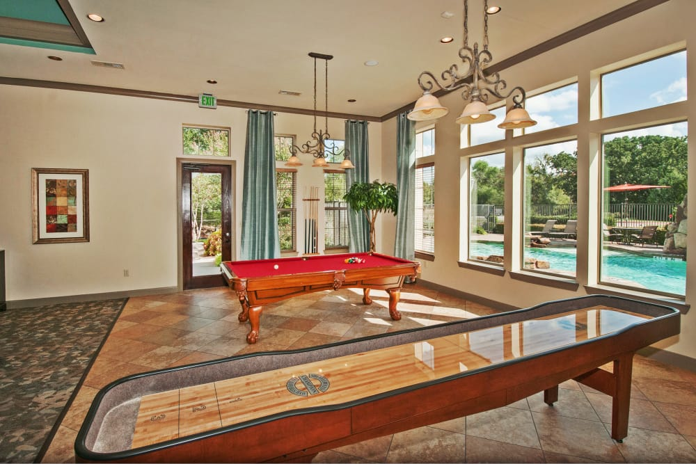 Billiards table and more in the resident clubhouse at The Landing at Mansfield in Mansfield, Texas