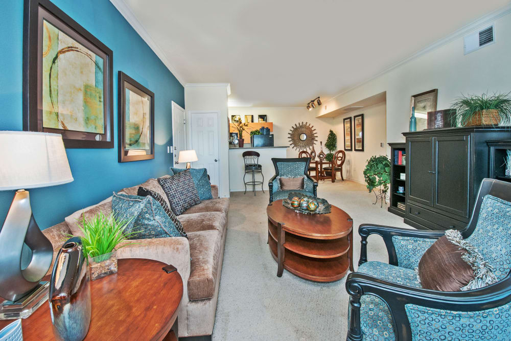 Spacious living room with modern decor in model home at The Landing at Mansfield in Mansfield, Texas
