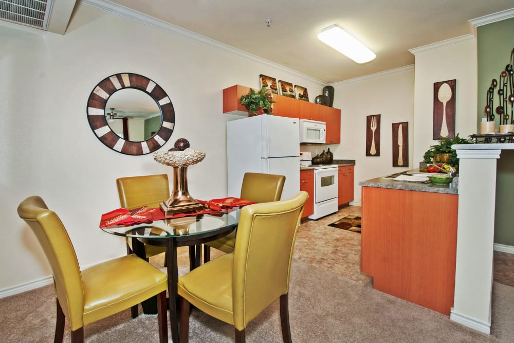 Dining area and gourmet kitchen in model home at The Landing at Mansfield in Mansfield, Texas
