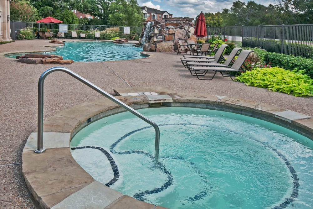 Hot tub near the swimming pool at The Landing at Mansfield in Mansfield, Texas