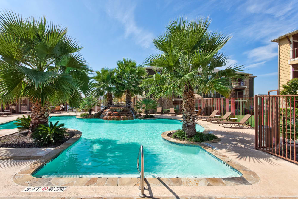 Sparkling swimming pool on a beautiful day at Springmarc Apartments in San Marcos, Texas