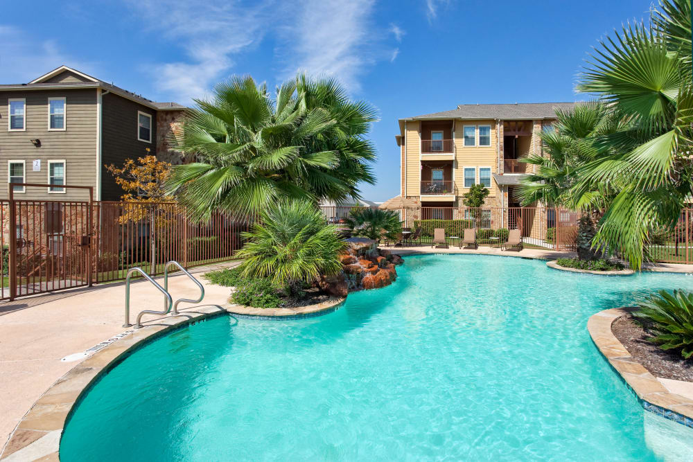 Swimming pool and resident buildings at Springmarc Apartments in San Marcos, Texas