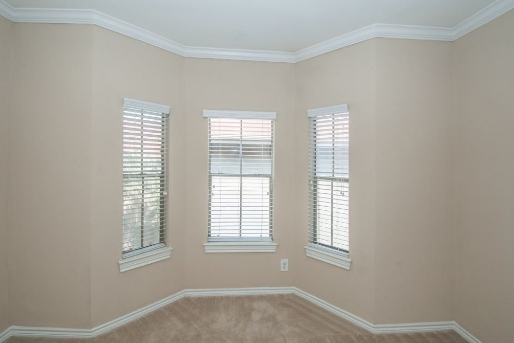 Bedroom with reading nook in apartment home at Rosemont at Olmos Park in San Antonio, Texas