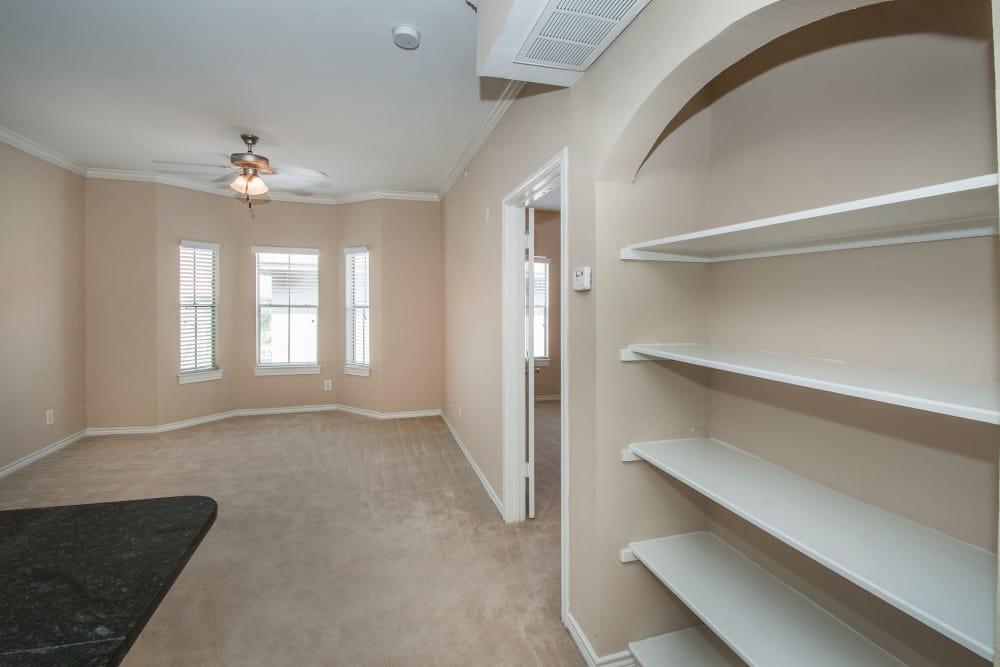 Built-in bookshelves and plush carpeting in apartment home at Rosemont at Olmos Park in San Antonio, Texas
