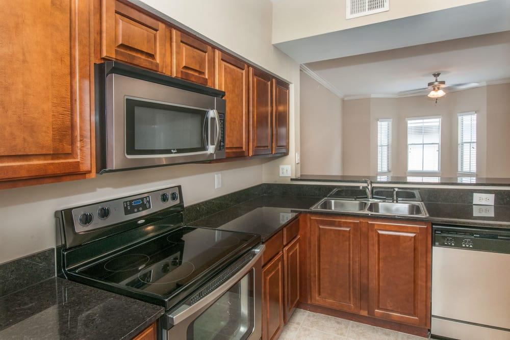 Gourmet kitchen with granite countertops in model home at Rosemont at Olmos Park in San Antonio, Texas
