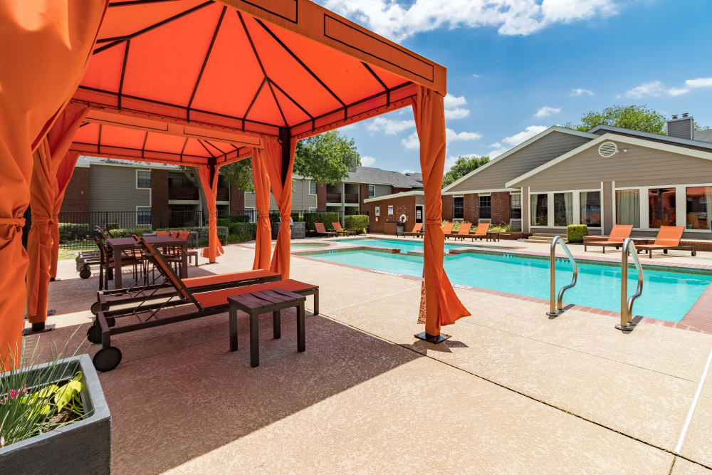 Shaded lounge area next to the pool in Allen, Texas at Presidio Apartments