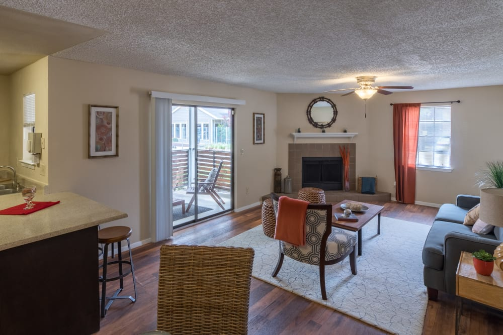 Living room with a ceiling fan at Presidio Apartments in Allen, Texas