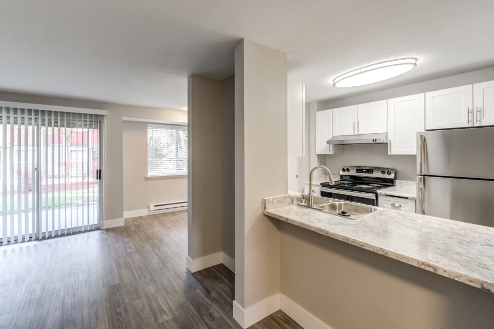 Model home at Chestnut Hills Apartments featuring a spacious floor plan layout with hardwood floors