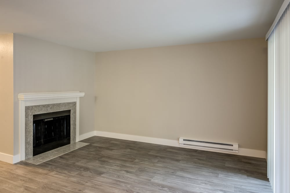 Chestnut Hills Apartments model home with hardwood floors and fireplace