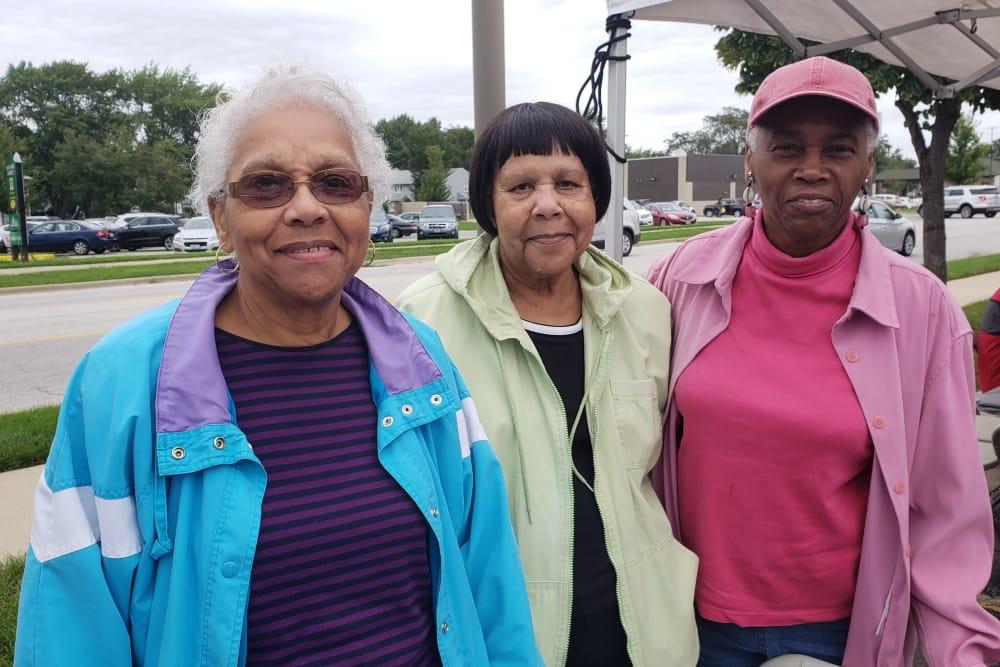three seniors taking a group photo
