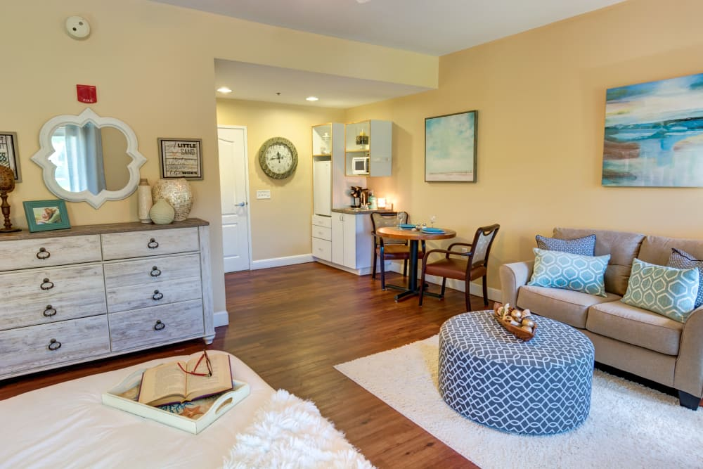 Resident bedroom with seating area at The Lynmoore at Lawnwood Assisted Living and Memory Care in Fort Pierce, Florida.