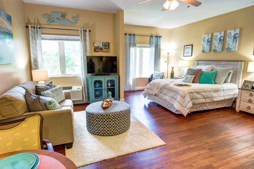 Spacious resident bedroom with large windows at The Lynmoore at Lawnwood Assisted Living and Memory Care in Fort Pierce, Florida.