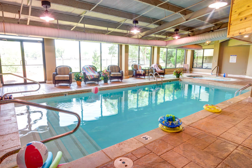 Indoor in-ground swimming pool at The Atrium at Serenity Pointe in Hot Springs, Arkansas