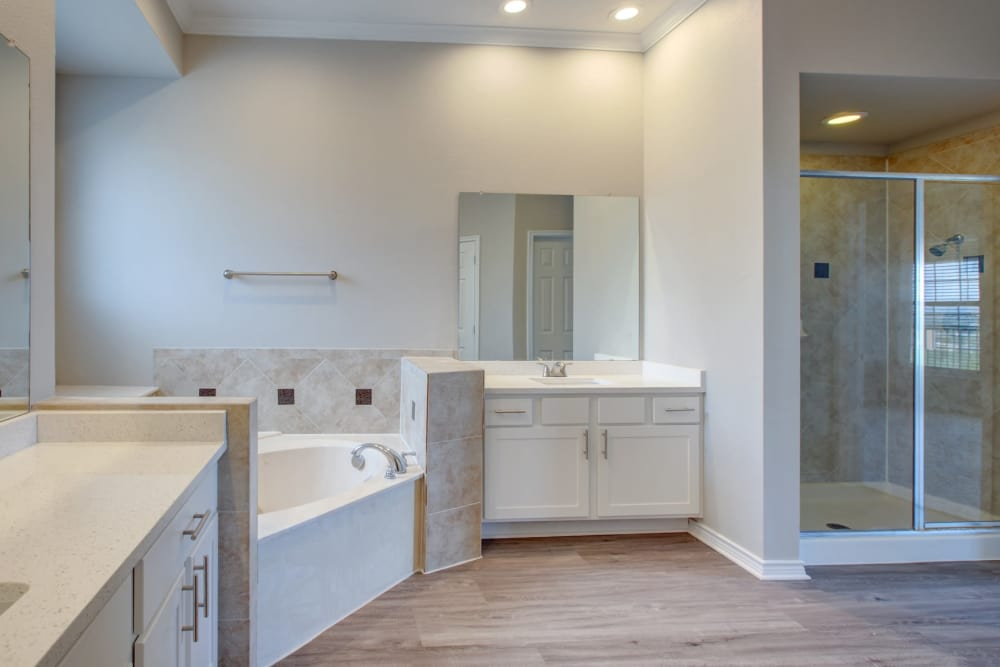 Newly remodeled bathroom with hardwood floors and garden tub in model home at Meritage at Steiner Ranch in Austin, Texas