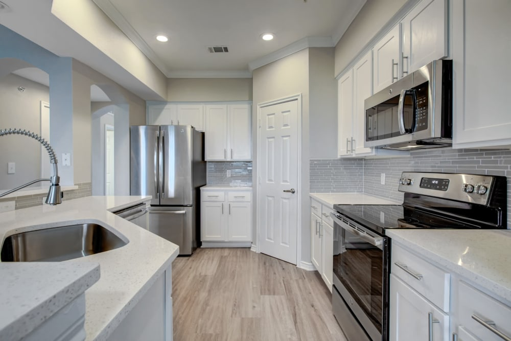 Newly remodeled kitchen in model home at Meritage at Steiner Ranch in Austin, Texas