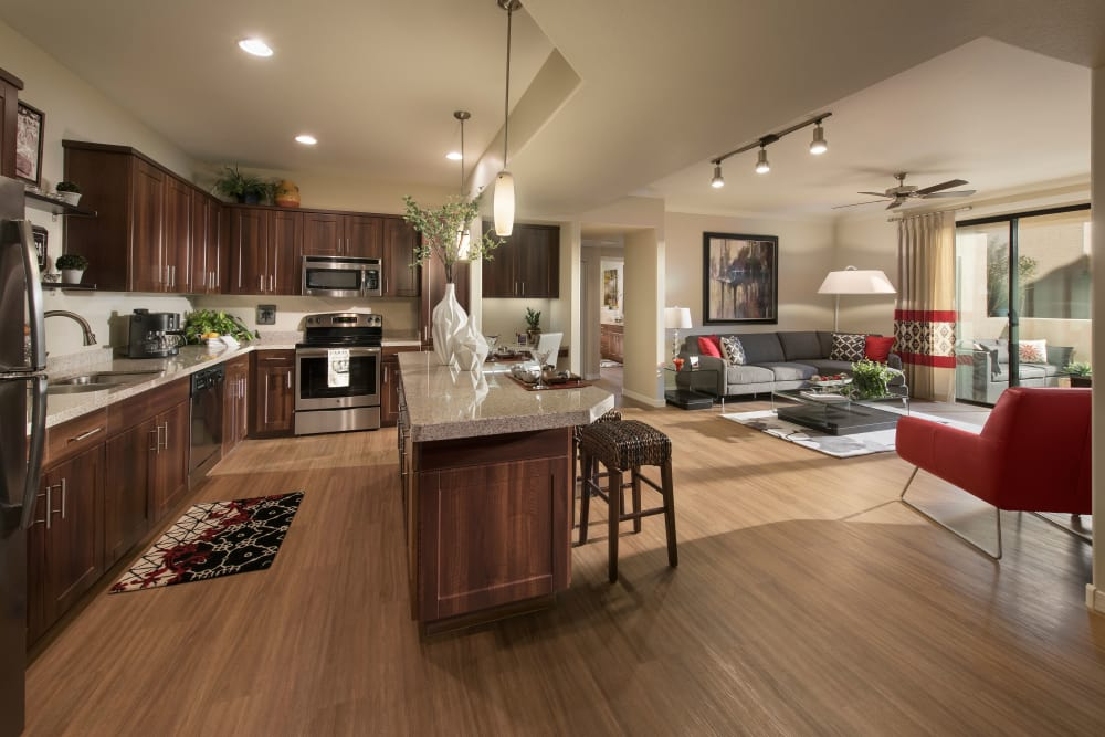 Beautiful open-concept floor plan with hardwood floors in model home at San Travesia in Scottsdale, Arizona