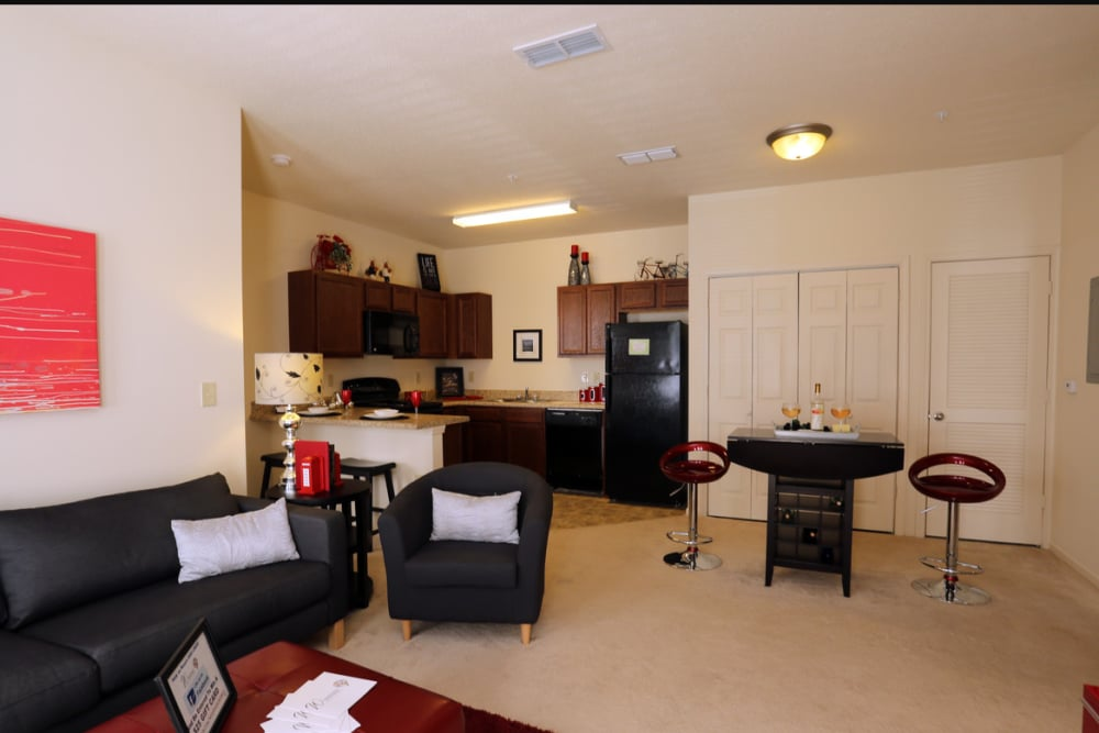 Apartments with a living room at Woodside in Mobile, Alabama