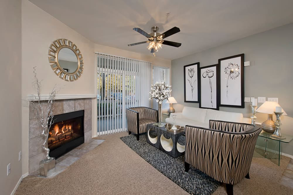 Comfy living room with fireplace at Center Pointe Apartment Homes in Beaverton, Oregon