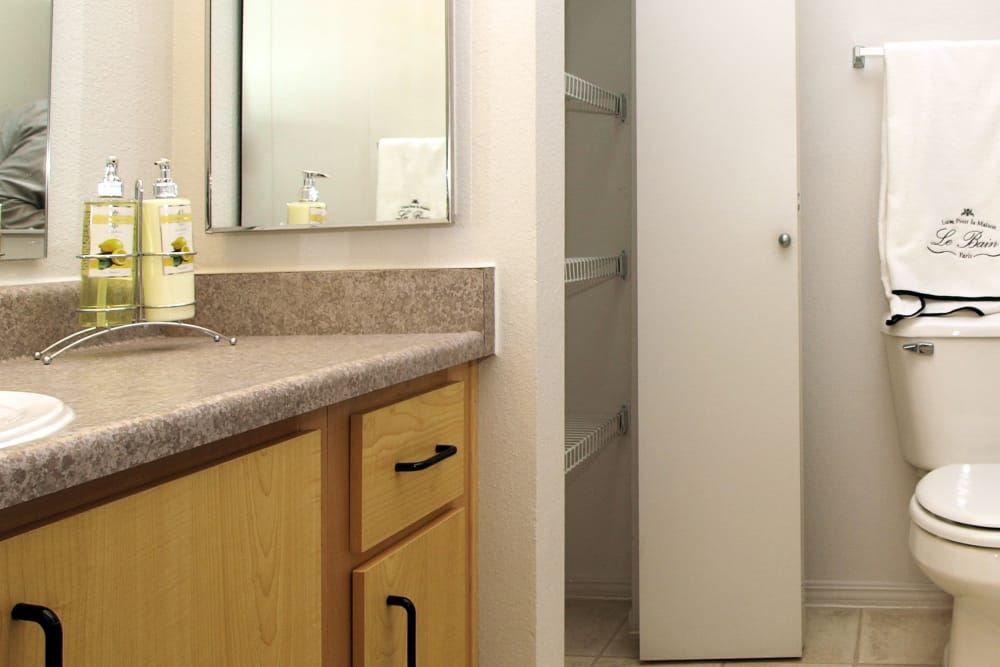 Lit bathroom at Center Pointe Apartment Homes in Beaverton, Oregon
