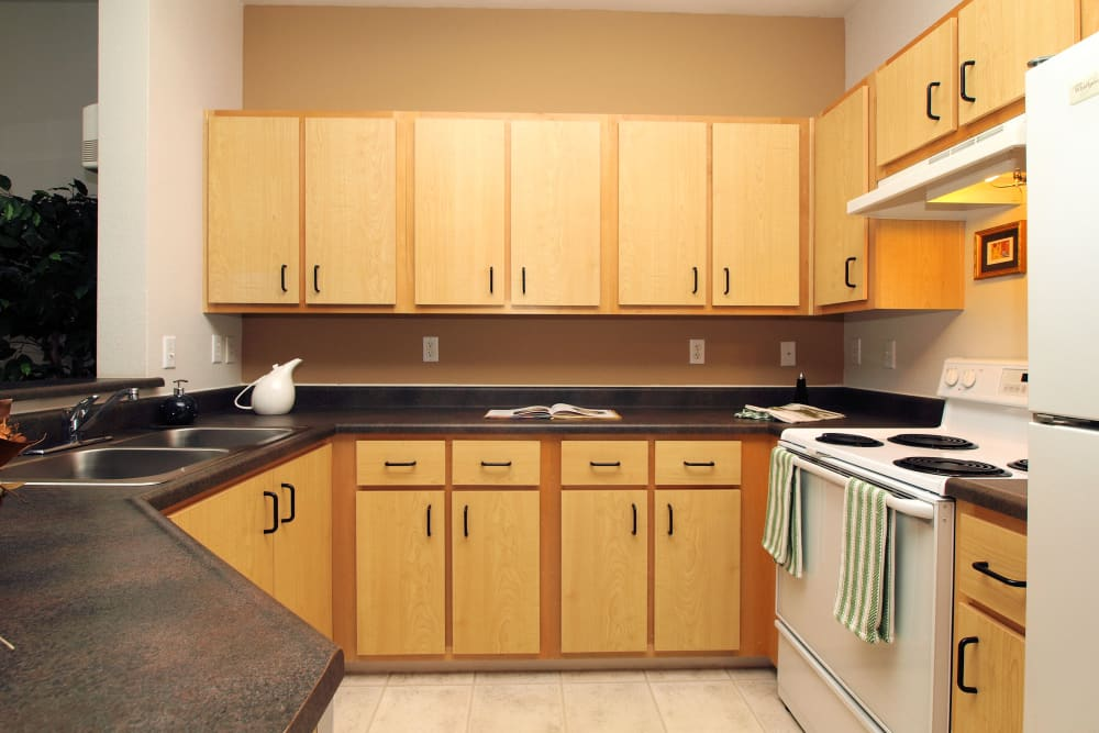 Lit kitchen at Center Pointe Apartment Homes in Beaverton, Oregon