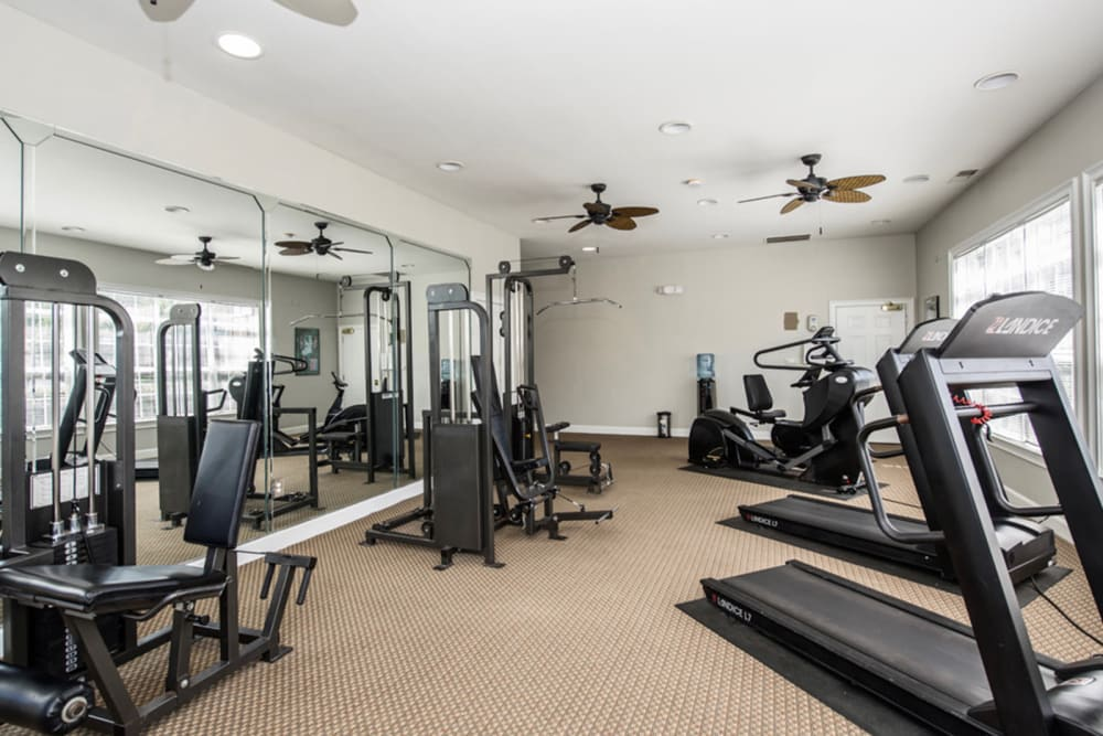Fully-equipped fitness center at Villas by the Lake in Jonesboro, Georgia